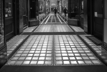 Glass tiles at the entrance to the Block Arcade, a man walking with a cane